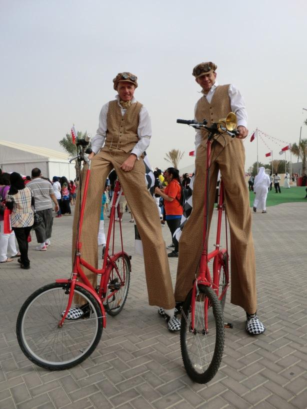 stilt cyclists